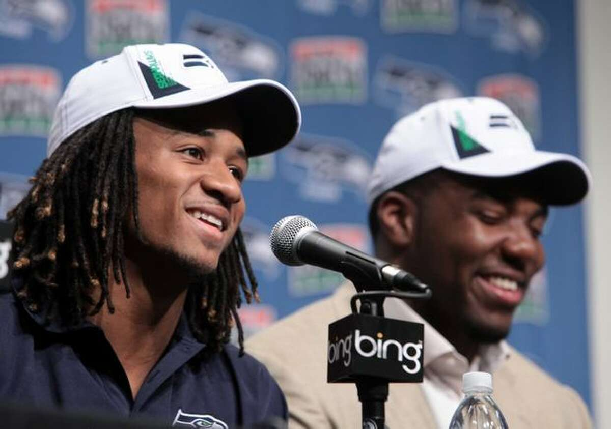 New Seattle Seahawks Earl Thomas from University of Texas, left, and Russell Okung from Oklahoma State talk about their first meeting, on the field, during a press conference on Saturday April 24, 2010 at the Virginia Mason Athletic Center in Renton. Okung was the Hawks first draft pick and Thomas was the teams second.(Joshua Trujillo, Seattlepi.com)....
