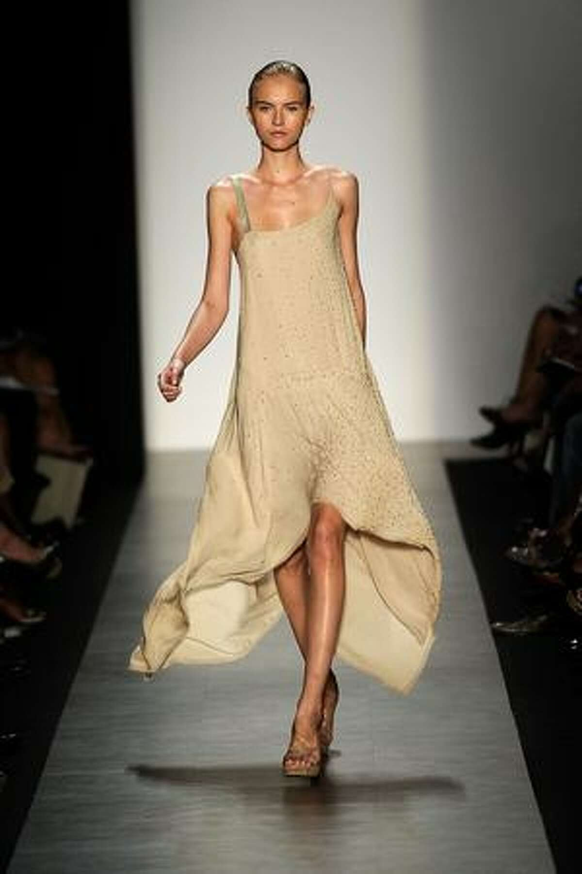 A model displays a creation by Max Azria.