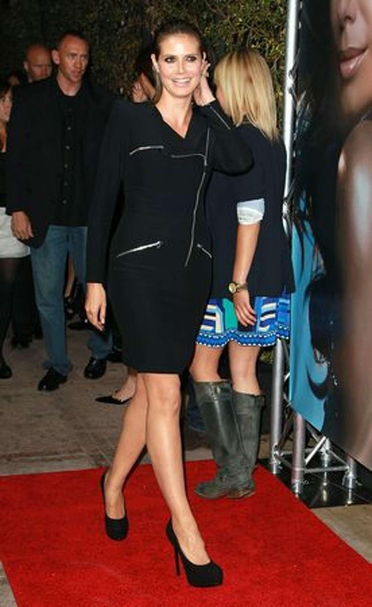 Model Heidi Klum attends the launch of Eva Longoria Parker's fragrance