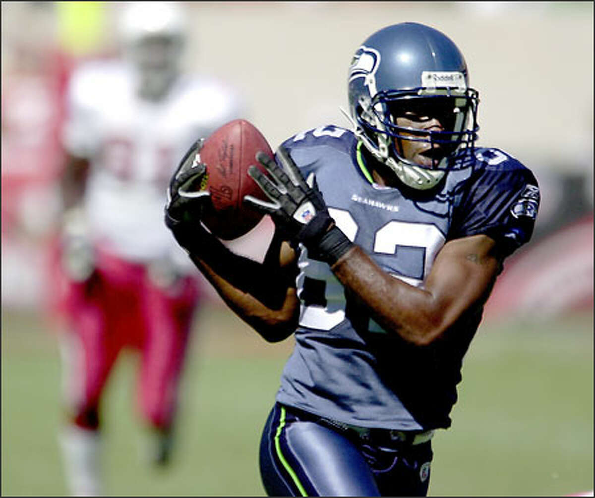 Seahawks wide receiver Darrell Jackson hauls down Matt Hasselbeck's pass en route to a 55-yard touchdown catch.