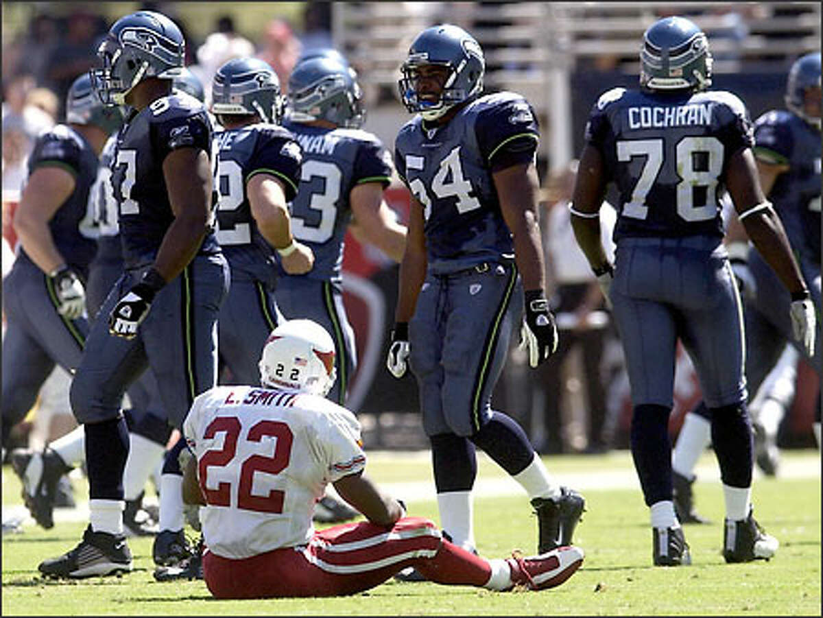 Cardinals running back Emmitt Smith watches the Seahawks defense leave the field after Smith fumbled during the second quarter. Smith was held to 54 yards on 14 carries.