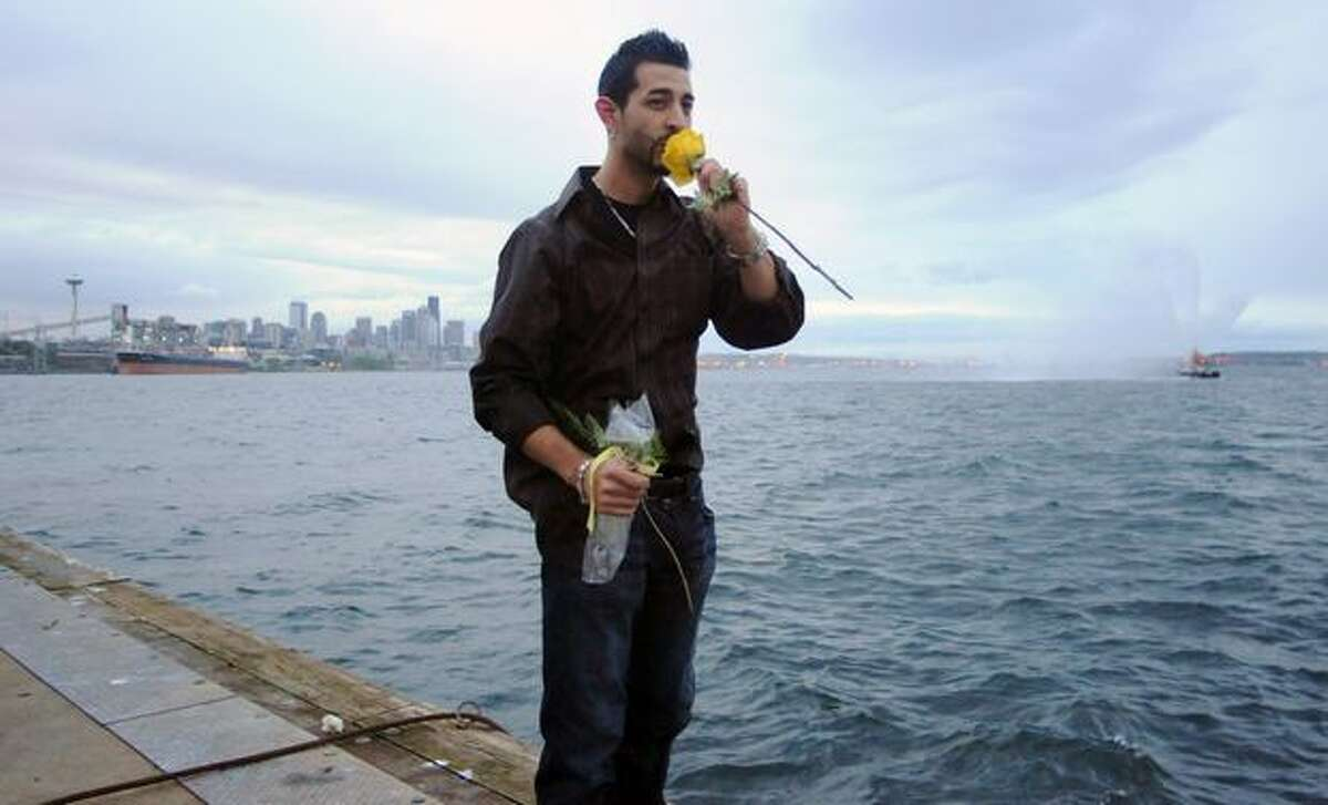 Josh Harris kisses a rose before tossing it into Elliott Bay to honor his father, Captain Phil Harris, at the Smith Cove Cruise Terminal at Pier 91 in Seattle April 30, 2010. Captain Phil Harris died February 9 from an aneurysm after suffering a massive stroke.