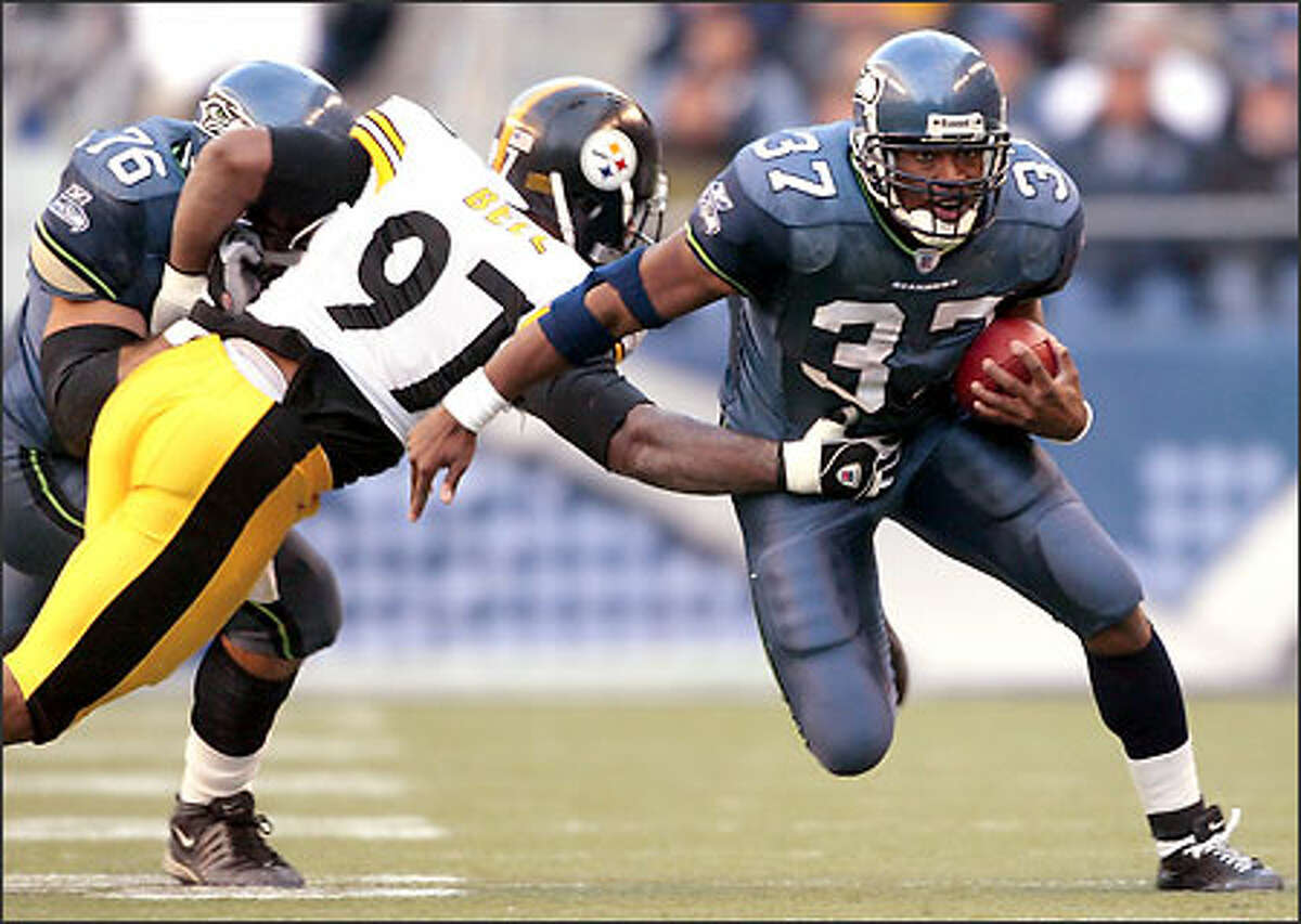 Shaun Alexander passes Pittsburgh's Kendrell Bell for a 1-yard gain with 2:39 left in the fourth quarter.
