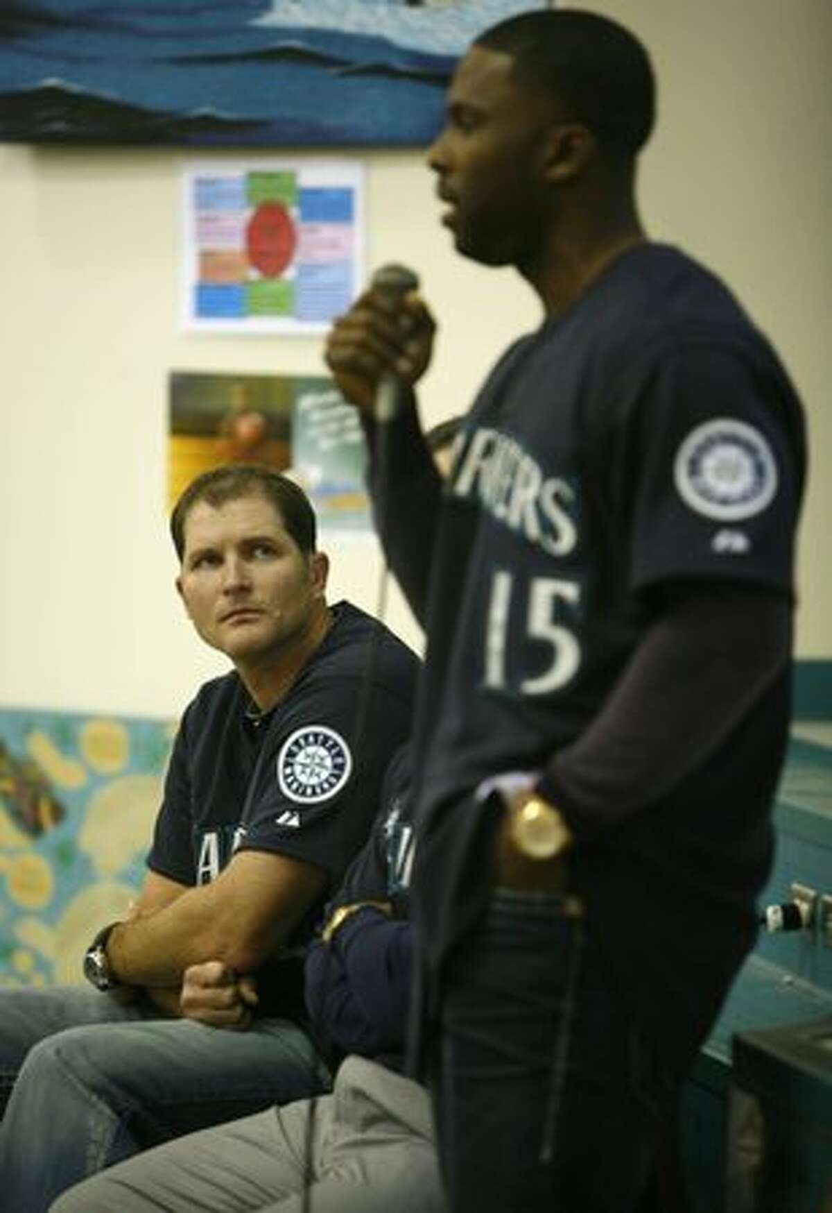 Seattle Mariners' player Mike Sweeney listens as teammate Milton Bradley talks to students during a visit by members of the team to Lakeridge Elementary School.