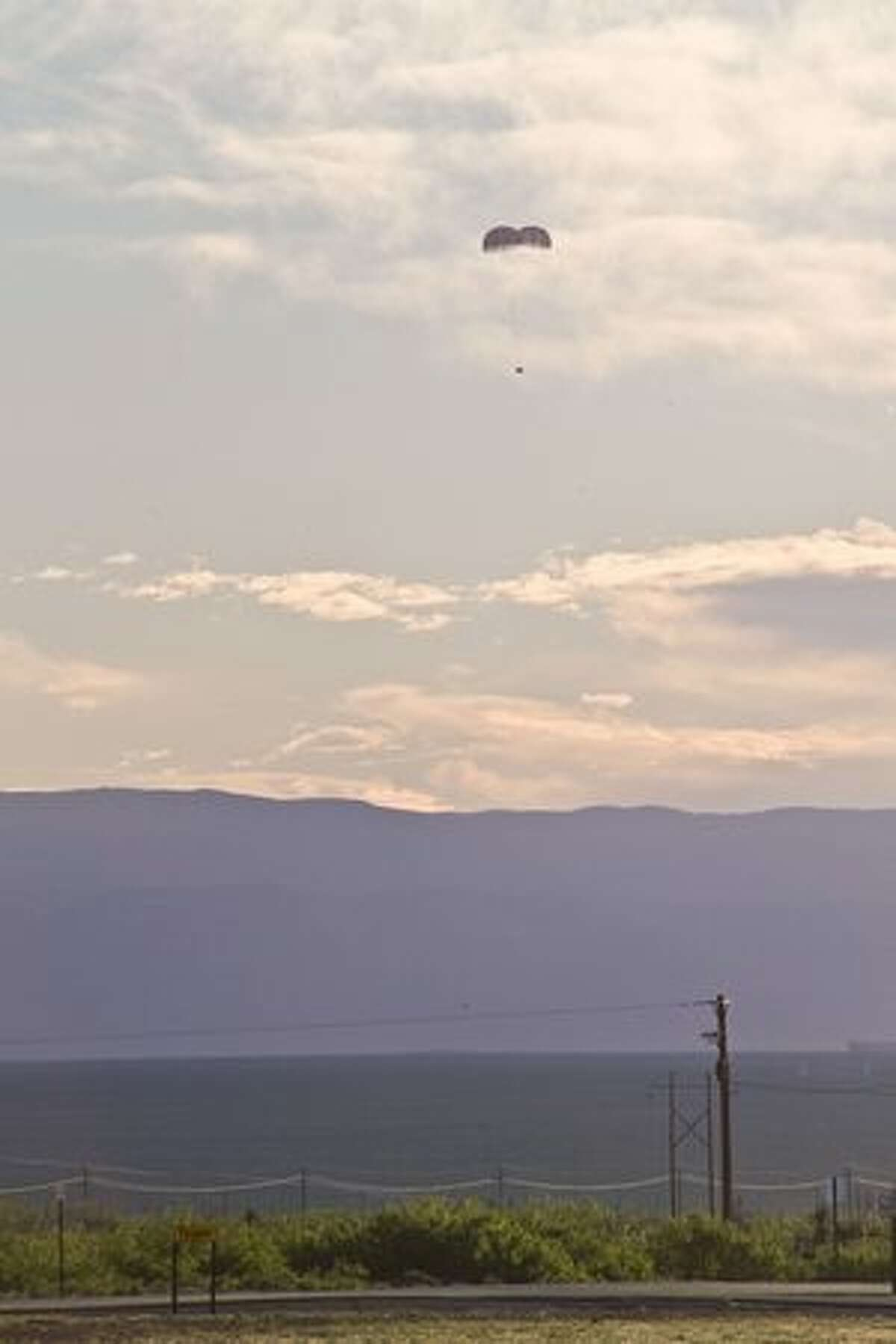 NASA Orion crew module floats back to Earth during a test of its abort system at White Sands Missile Range, N.M.