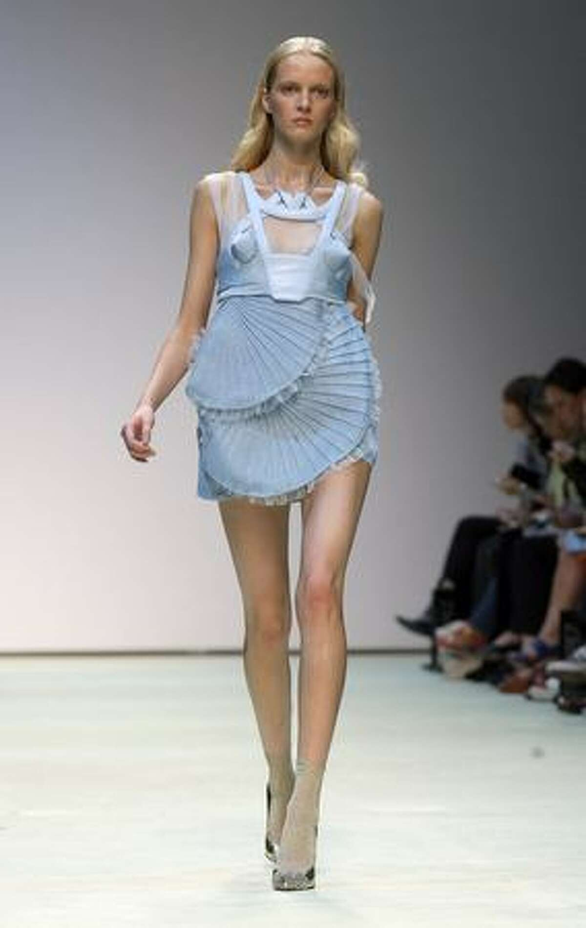 A model displays a creation by Louise Goldin spring/summer 2010 show during London Fashion Week at the TopShop Show Space in London on Sunday, Sept. 20, 2009.