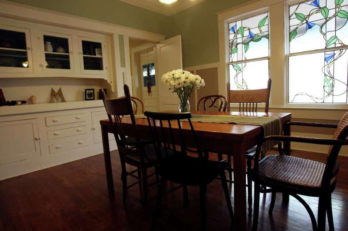 Partain's bungalow includes a dining room with stained glass windows and hardwood floors.