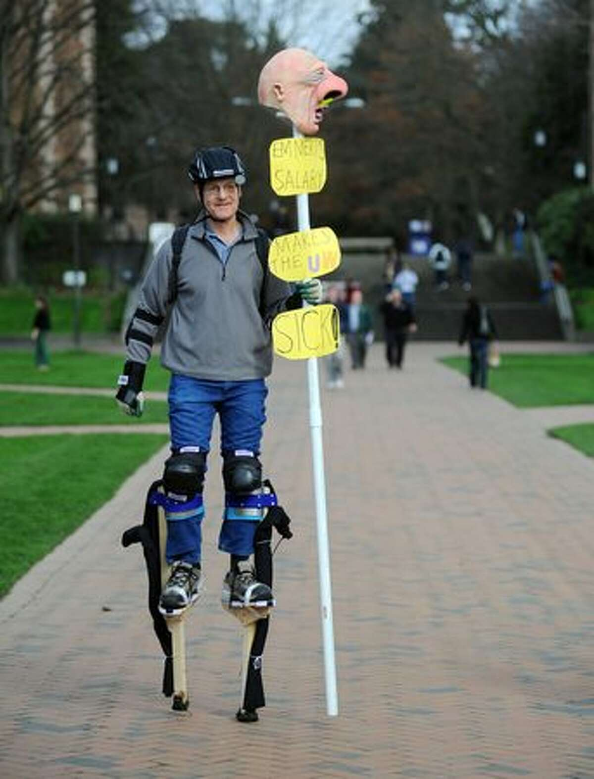 Jay Herzmark, a member of Local 1488, the union representing the University of Washington in the strike against increased tuitions and upcoming state budget cuts for colleges, walks around on stilts.