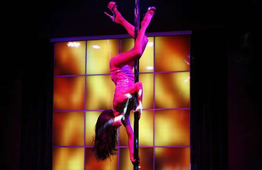 A dancer performs during a press tour of Dream Girls, the Déjà Vu chain's newest strip club at 1530 First Avenue South, next to Safeco Field. Photo: Joshua Trujillo, Seattlepi.com / seattlepi.com