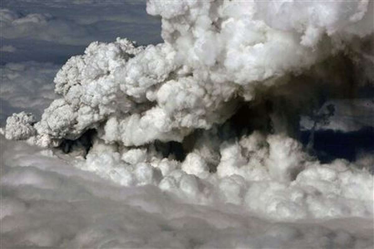 In this image made available by the Icelandic Coastguard, taken, Wednesday April 14, 2010, smoke and steam rises from the volcano under the Eyjafjallajokull glacier in Iceland, which erupted for the second time in less than a month, melting ice, shooting smoke and steam into the air and forcing hundreds of people to flee rising floodwaters. (AP Photo/Icelandic Coastguard, ho)