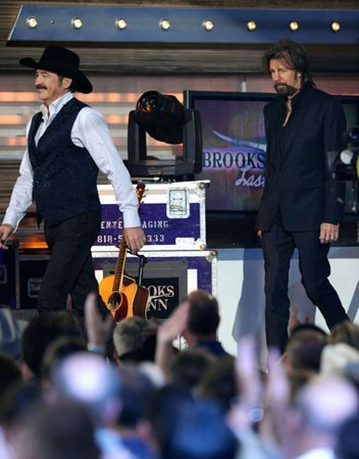 Musicians Kix Brooks (left) and Ronnie Dunn of the band Brooks & Dunn walk onstage.