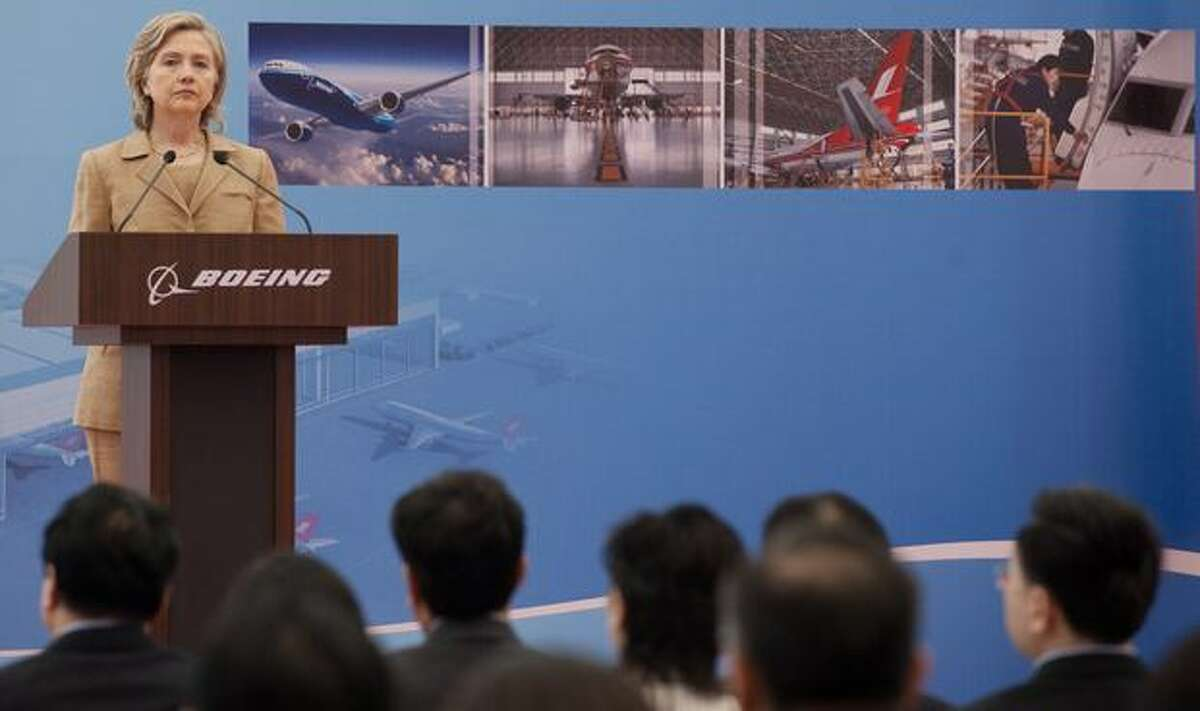 U.S. Secretary of State Hillary Clinton speaks on commercial development at the Boeing Maintenance Facility at Pudong International Airport in Shanghai.