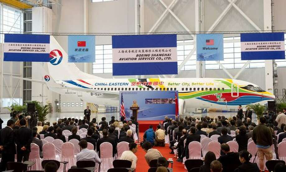 Then U.S. Secretary of State Hillary Clinton speaks on commercial development in front of a China Eastern Boeing 737 at the Boeing Maintenance Facility at Pudong International Airport in Shanghai in 2010. Photo: Getty Images