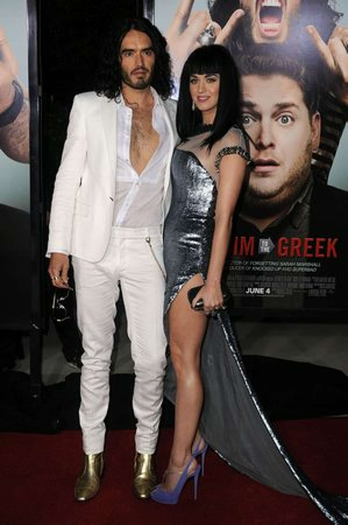 """Actor/comedian Russell Brand (L) and singer Katy Perry arrive at the premiere of Universal Pictures' """"Get Him To The Greek"""" held at the Greek Theatre in Los Angeles, California."""