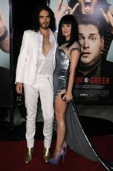 "Actor/comedian Russell Brand (L) and singer Katy Perry arrive at the premiere of Universal Pictures' ""Get Him To The Greek"" held at the Greek Theatre in Los Angeles, California. Photo: Getty Images"