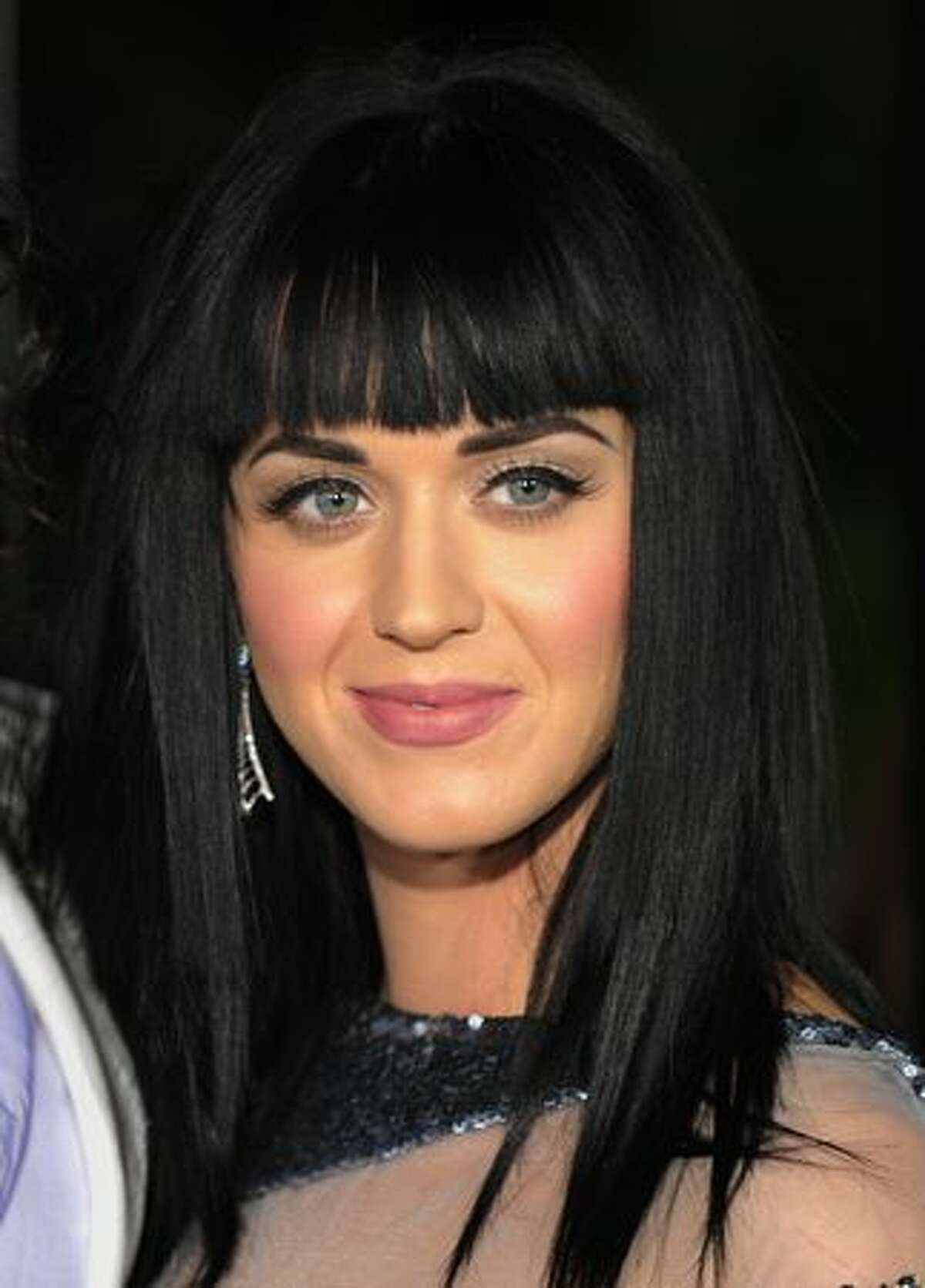 Singer Katy Perry poses on the red carpet as she arrives for the premiere of the comedy movie