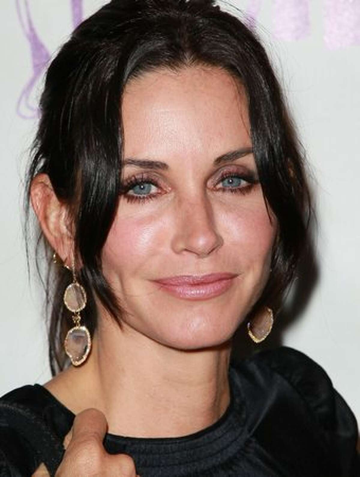 Actress Courteney Cox attends the 15th Annual Los Angeles Antique Show Opening Night Preview Party benefiting P.S. ARTS at Barker Hanger on April 21, 2010 in Santa Monica, California.