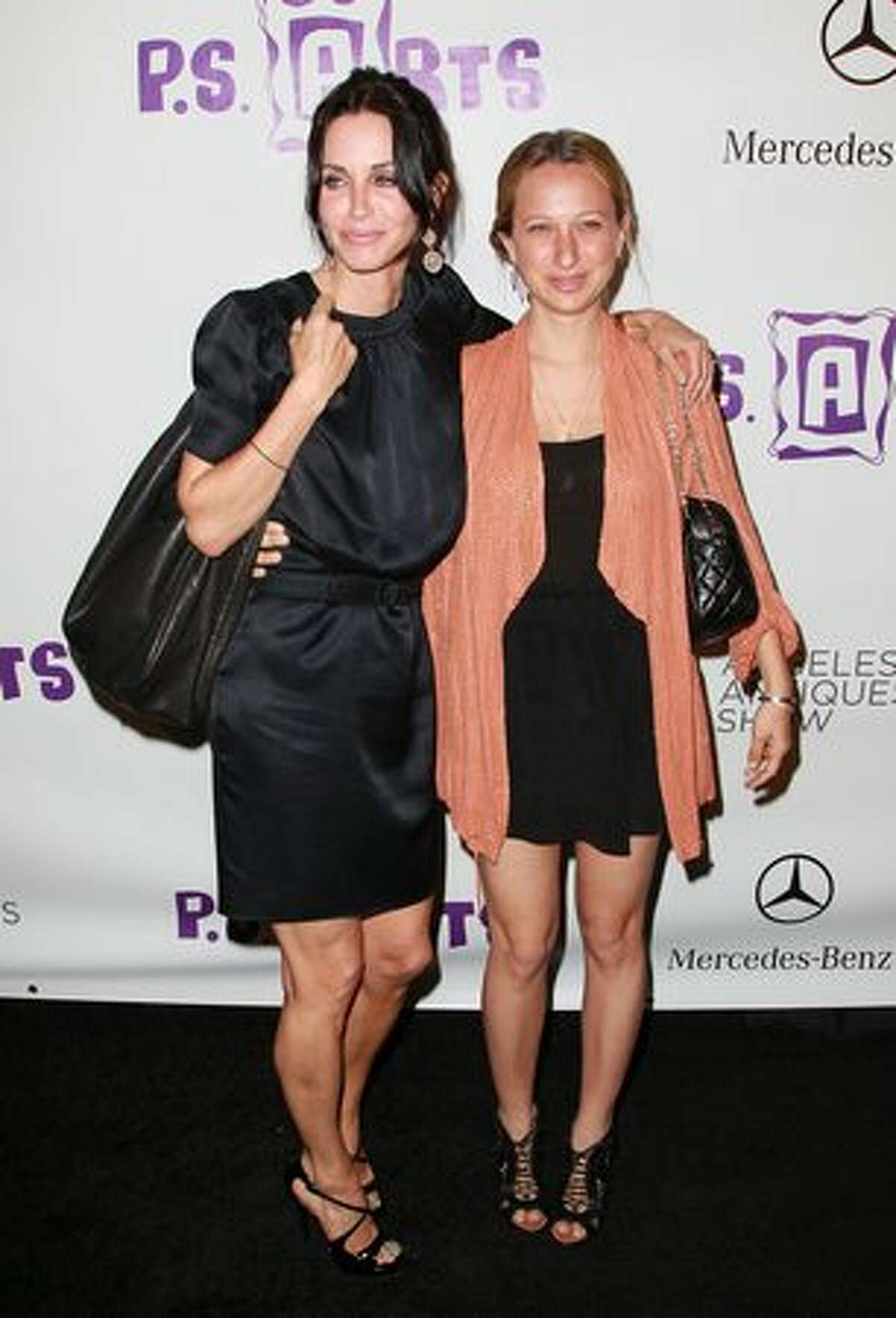 Actress Courteney Cox (L) and Jennifer Meyer-Maguire attend the 15th Annual Los Angeles Antique Show Opening Night Preview Party benefiting P.S. ARTS at Barker Hanger on April 21, 2010 in Santa Monica, California.