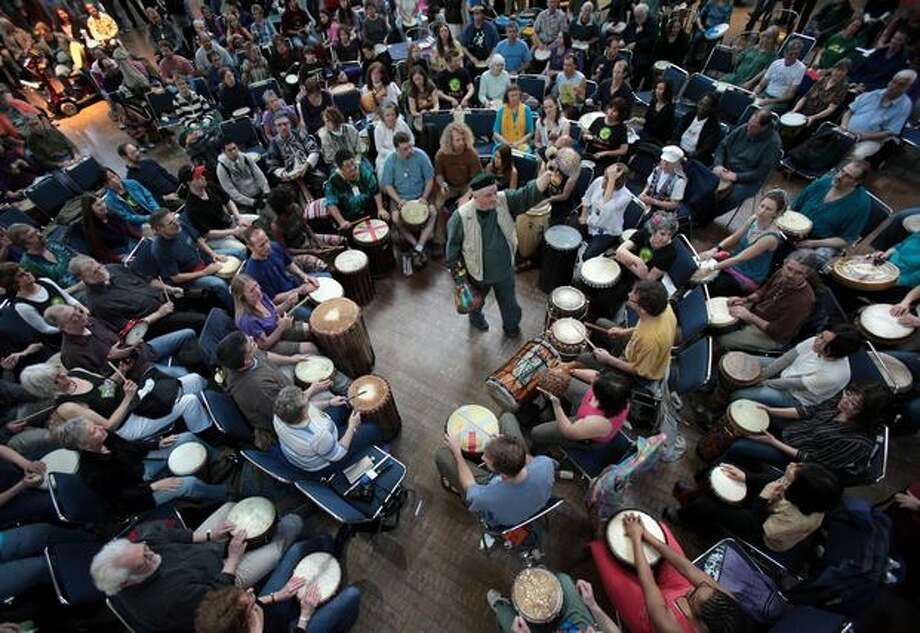 Arthur Hull directs The Great Northwest Drum Circle during the World Rhythm Festival at the Seattle Center on Saturday April 24, 2010. The three day event features dancing, performances, workshops and of course drum circles. Photo: Joshua Trujillo, Seattlepi.com