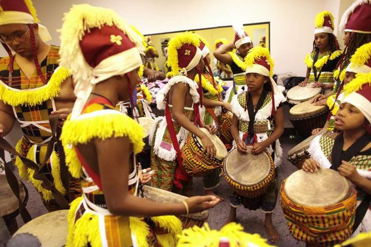 Members of Oakland, Calif. music and dancing group Bumpitythump prepare to go onstage during the World Rhythm Festival at the Seattle Center on Friday April 23, 2010. The three day event features performances, workshops and drum circles.