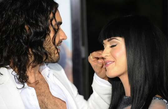 "Actor Russell Brand and partner singer Katy Perry pose on the red carpet as they arrive for the premiere of the comedy movie ""Get Him to the Greek"" from Universal Pictures at the Greek Theatre in Los Angeles. Photo: Getty Images"