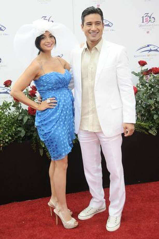 Mario Lopez and Courtney Laine Mazza attend the 136th Kentucky Derby in Louisville, Kentucky. Photo: Getty Images
