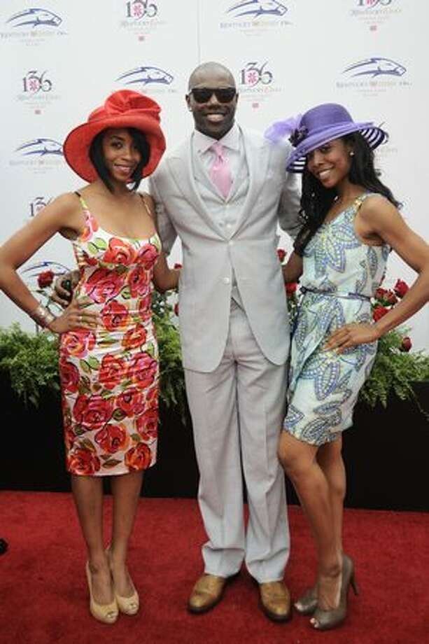 Terrell Owens, BJ Williams, left, and Kita Williams attends the 136th Kentucky Derby in Louisville, Kentucky. Photo: Getty Images