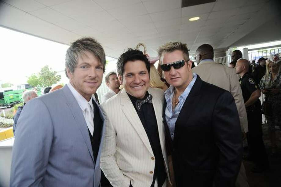 Joe Don Rooney, Jay DeMarcus and Gary LeVox of the country music band Rascal Flatts attend the 136th Kentucky Derby in Louisville, Kentucky. Photo: Getty Images