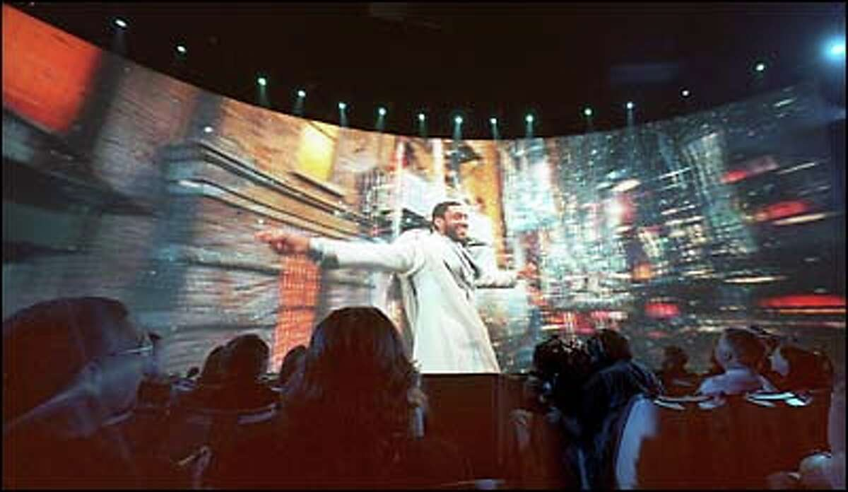 In Artist's Journey, the Archangel of Funk (actor Harry J. Lennix) performs on a giant screen in