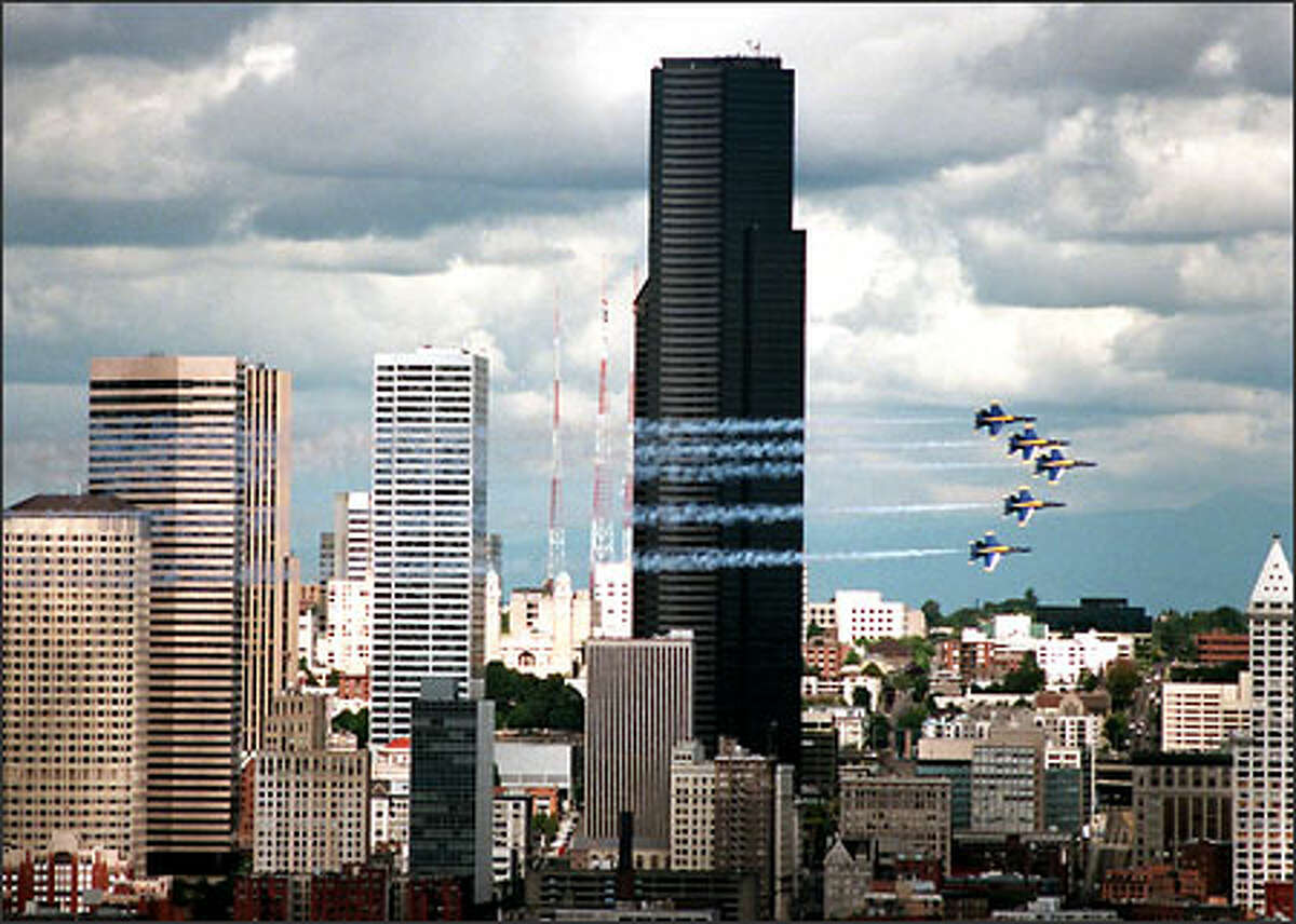 The Blue Angels streak across the Seattle skyline.