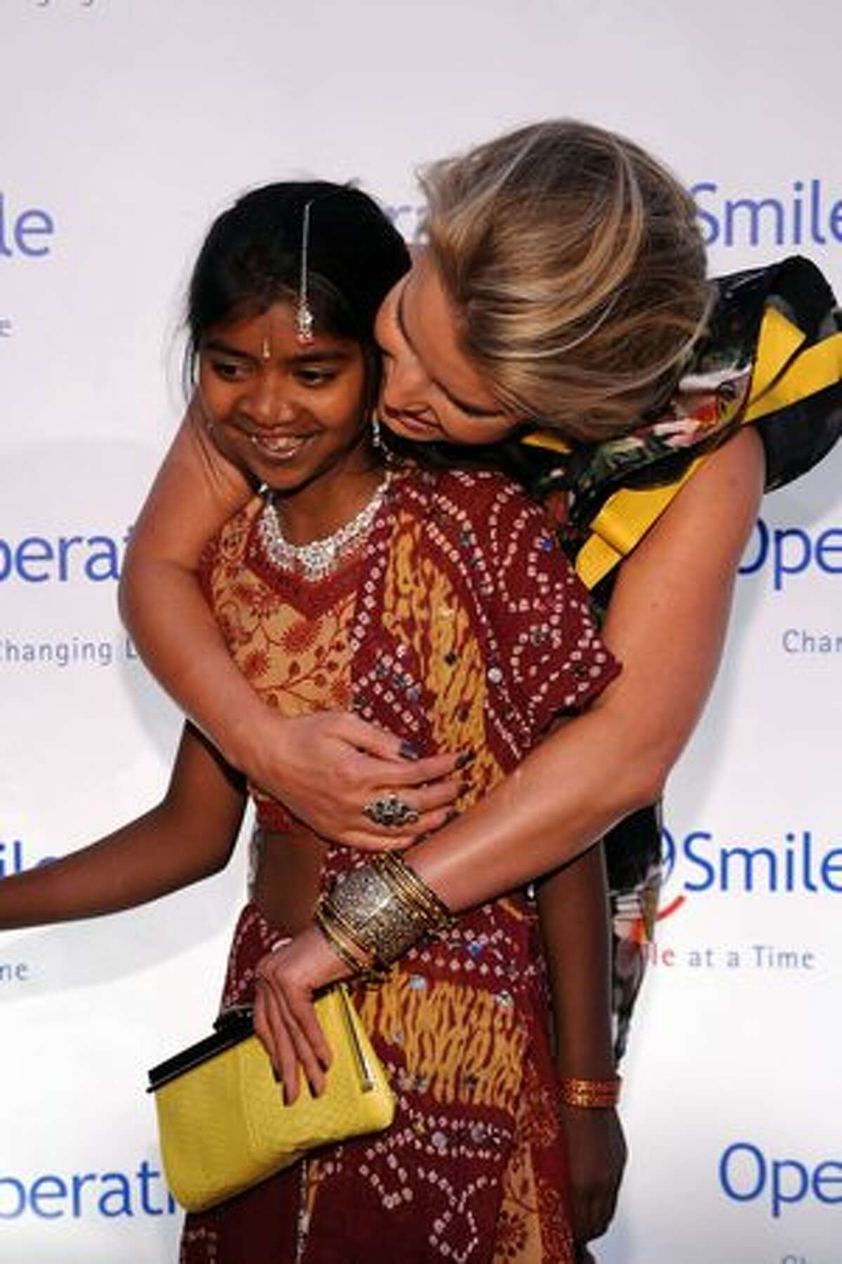 Singer Jessica Simpson and Operation Smile patient Meena attend the 2010 Operation Smile annual gala at Cipriani, Wall Street on May 6, 2010 in New York City.