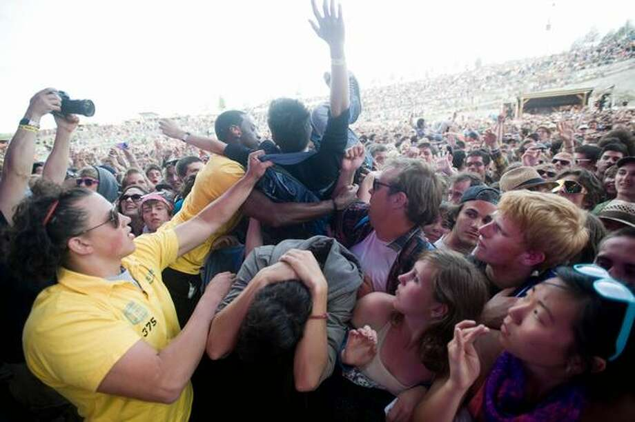 Crowd surfers are pulled from the audience at Sasquatch! Music Festival. Photo: Chona Kasinger, Seattlepi.com