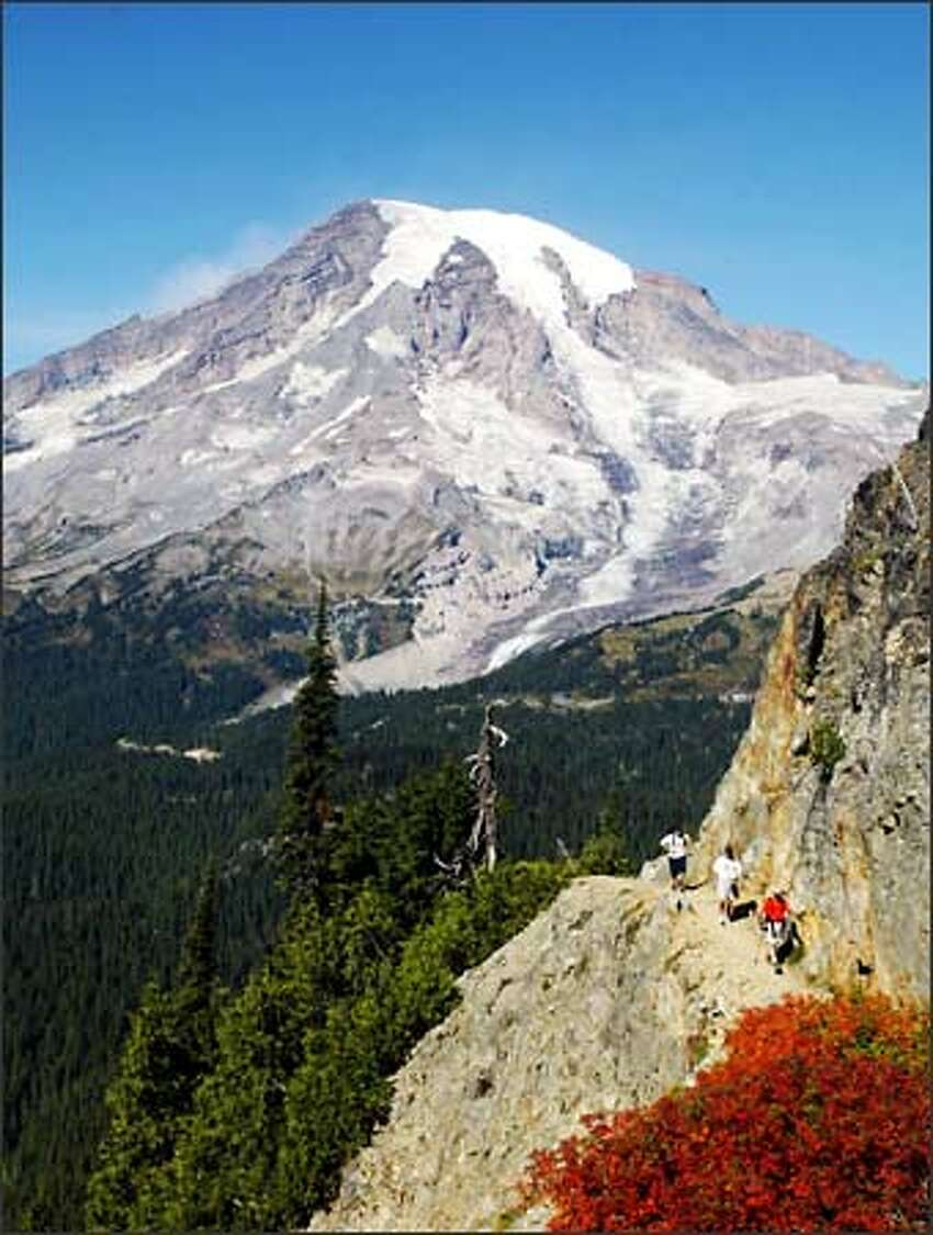 Hikers make their way up the trail to Pinnacle Saddle in Mount Rainier National Park.