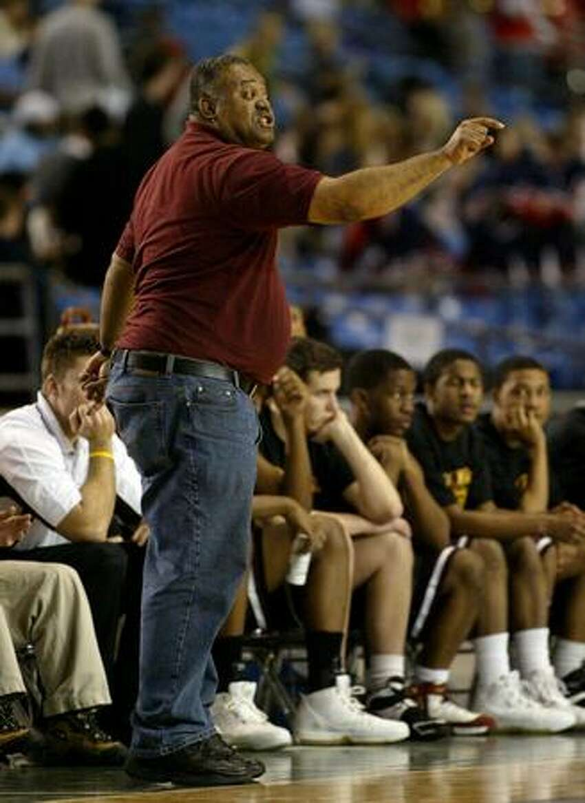 O'Dea basketball coach Phil Lumpkin in the fourth quarter of a 2006 playoff game against North Central High School of Spokane. O'Dea won the game 65-64 in the first round of the Class 3A state tournament. (Scott Eklund/seattlepi.com file)