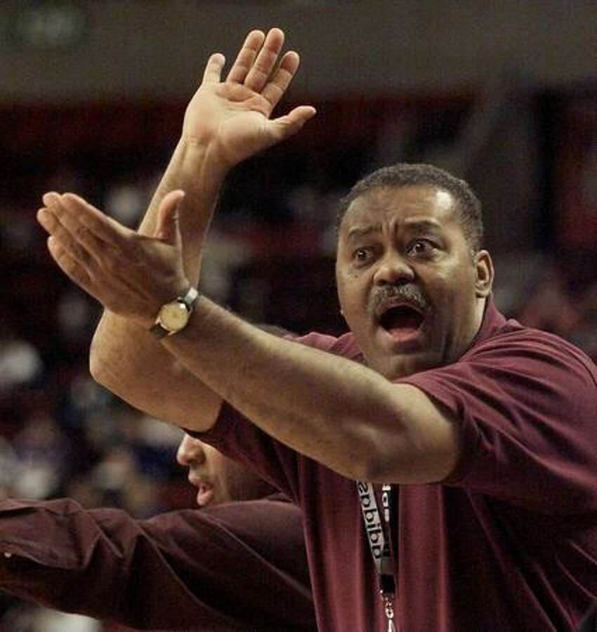 O'Dea basketball coach Phil Lumpkin scolds the referees during his team's loss to the Franklin Quakers, Jan. 17, 2000. (Mike Urban/seattlepi.com file)