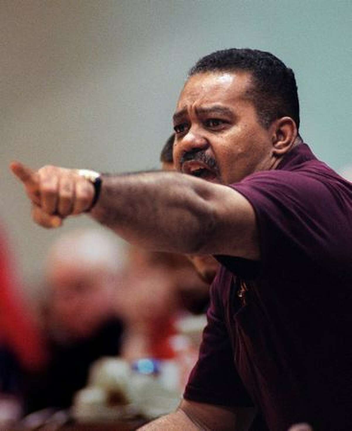 O'Dea basketball coach Phil Lumpkin yells to a player during the 1997 basketball championship tournament at Seattle Pacific University. O'Dea kept its perfect record intact and won the Sea-King District title that night, beating Cleveland 84-54. (Ellen M. Banner/seattlepi.com file)