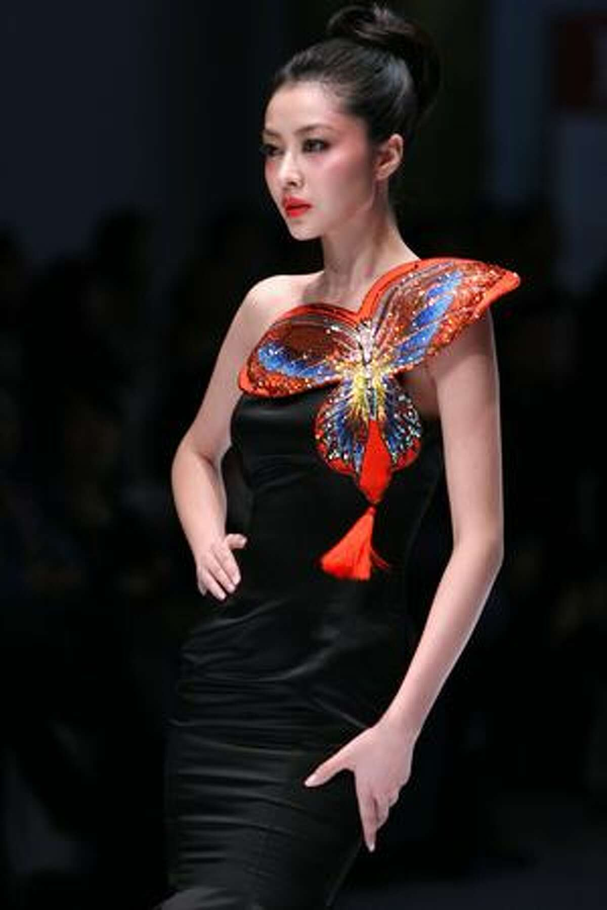A model displays a creation from the NE TIGER Haute Couture Collection during the China Fashion Week in Beijing.