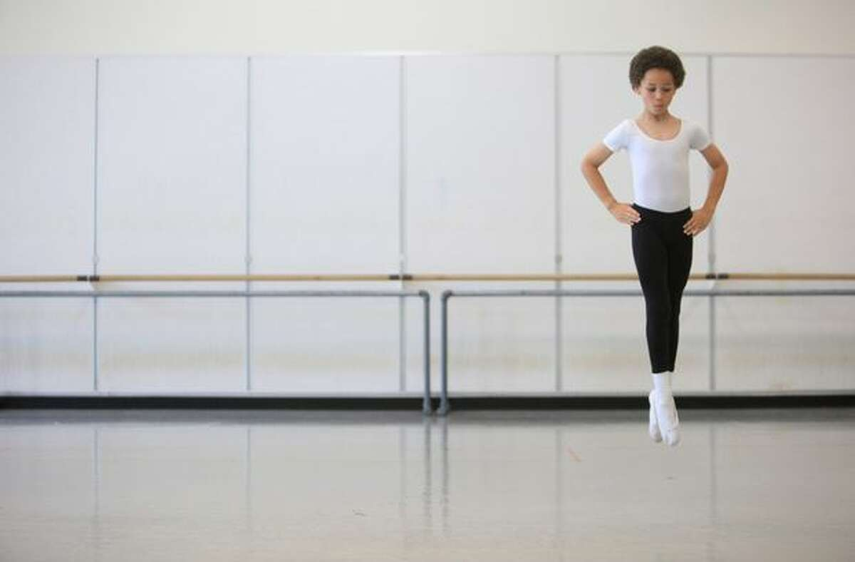 A DanceChance student perform for family, friends and teachers on June 1, 2010 at Pacific Northwest Ballet in Seattle. The DanceChance program, in its 16th year, visits under-served schools and communities where potential students audition for the program. Students chosen for the program are given a scholarship which includes dance clothing, transportation and tickets to the ballet.