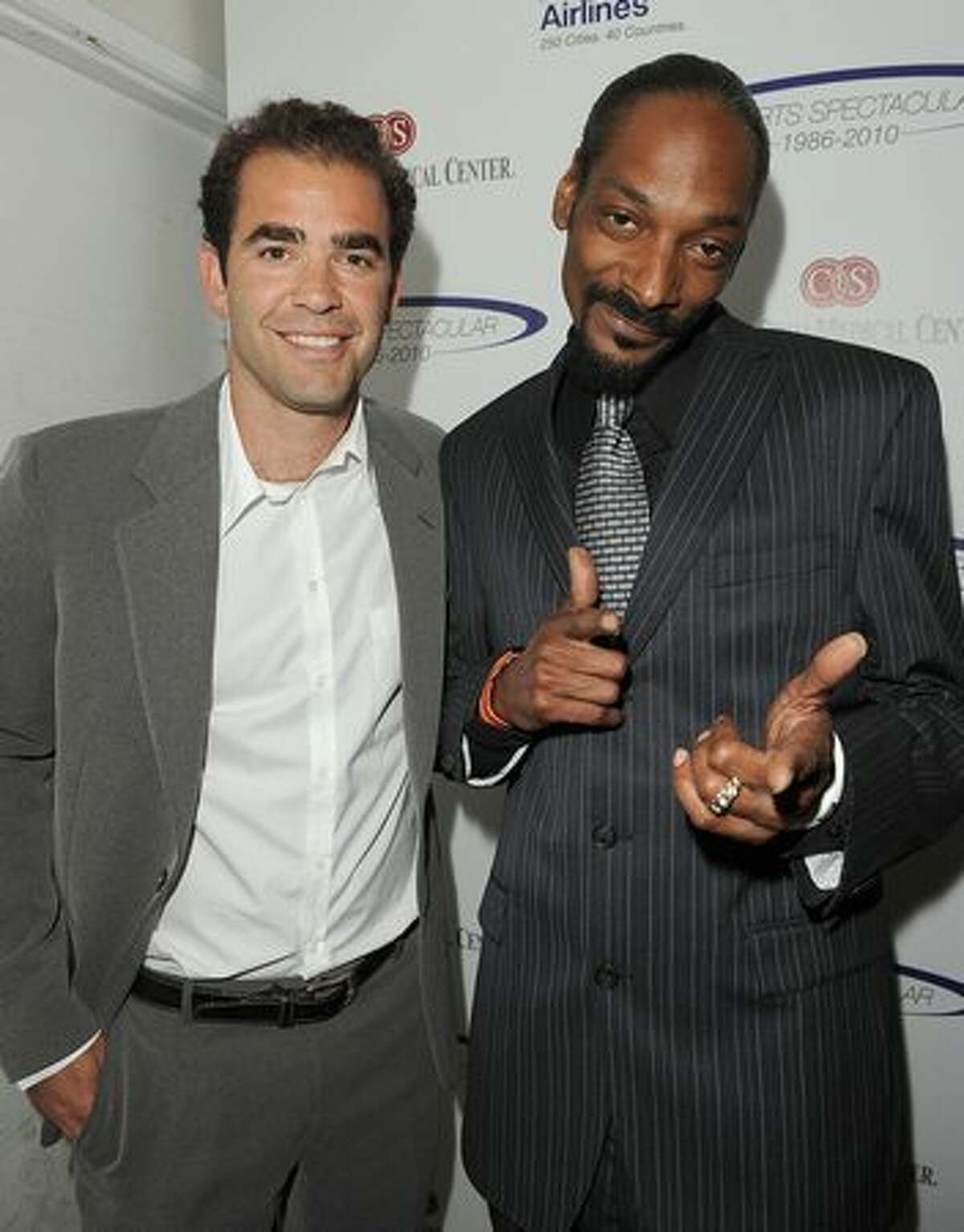 Tennis player Pete Sampras and singer Snoop Dogg pose backstage at the 25th Anniversary Of Cedars-Sinai Sports Spectacular held at the Hyatt Regency Century Plaza Hotel.