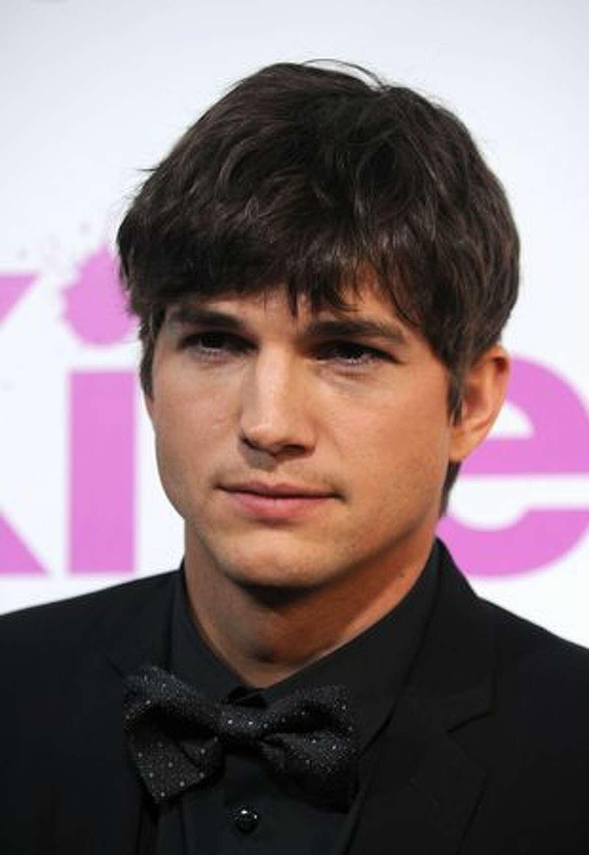 Actor Ashton Kutcher arrives to the premiere of Lionsgate's