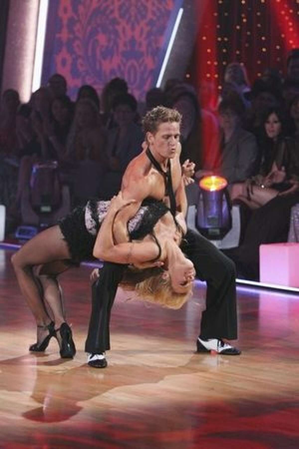 Previously eliminated couple Damian Whitewood and Pamela Anderson perform.