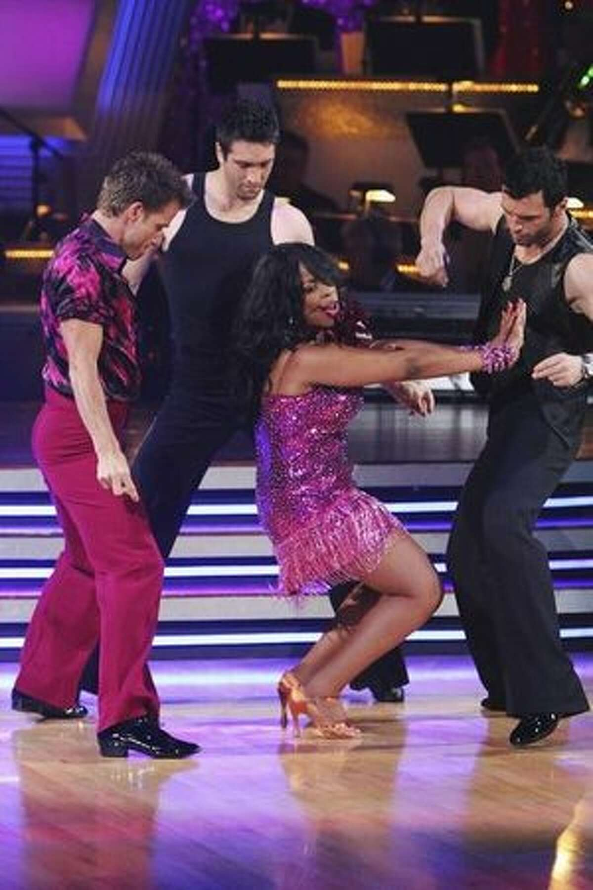 Pro dancers Louis van Amstel, Dmitry Chaplin and Tony Dovolani dance with actress Niecy Nash.
