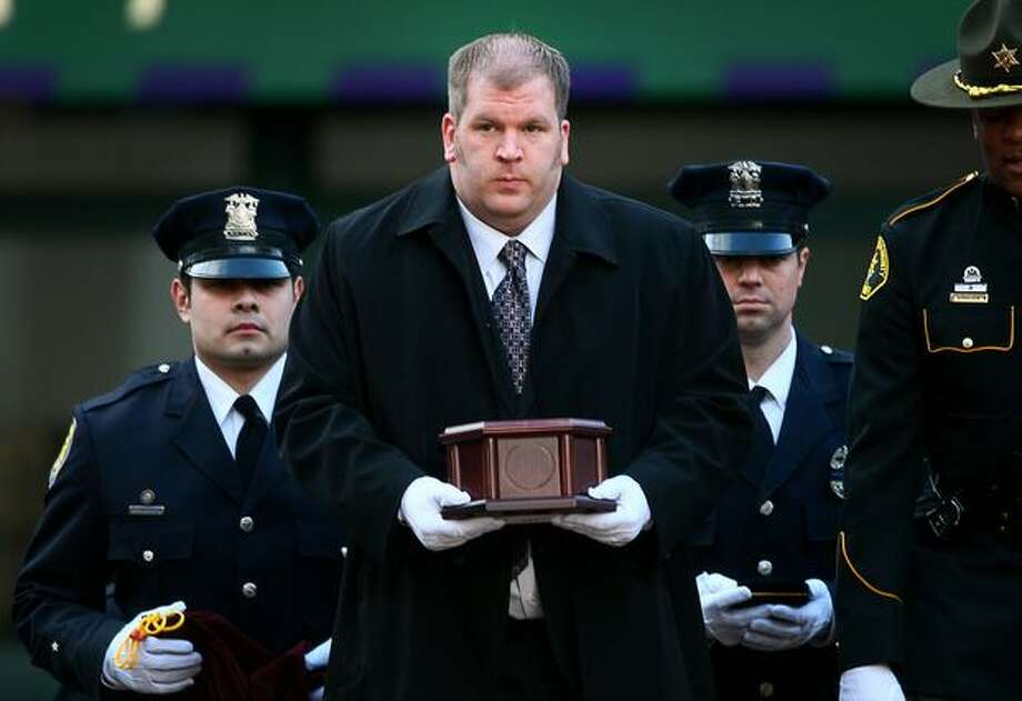 Seattle Police Officer Timothy Brenton's brother Matt carries his remains from KeyArena in Seattle, following a memorial service for the slain police officer. Photo: Thom Weinstein, Seattlepi.com