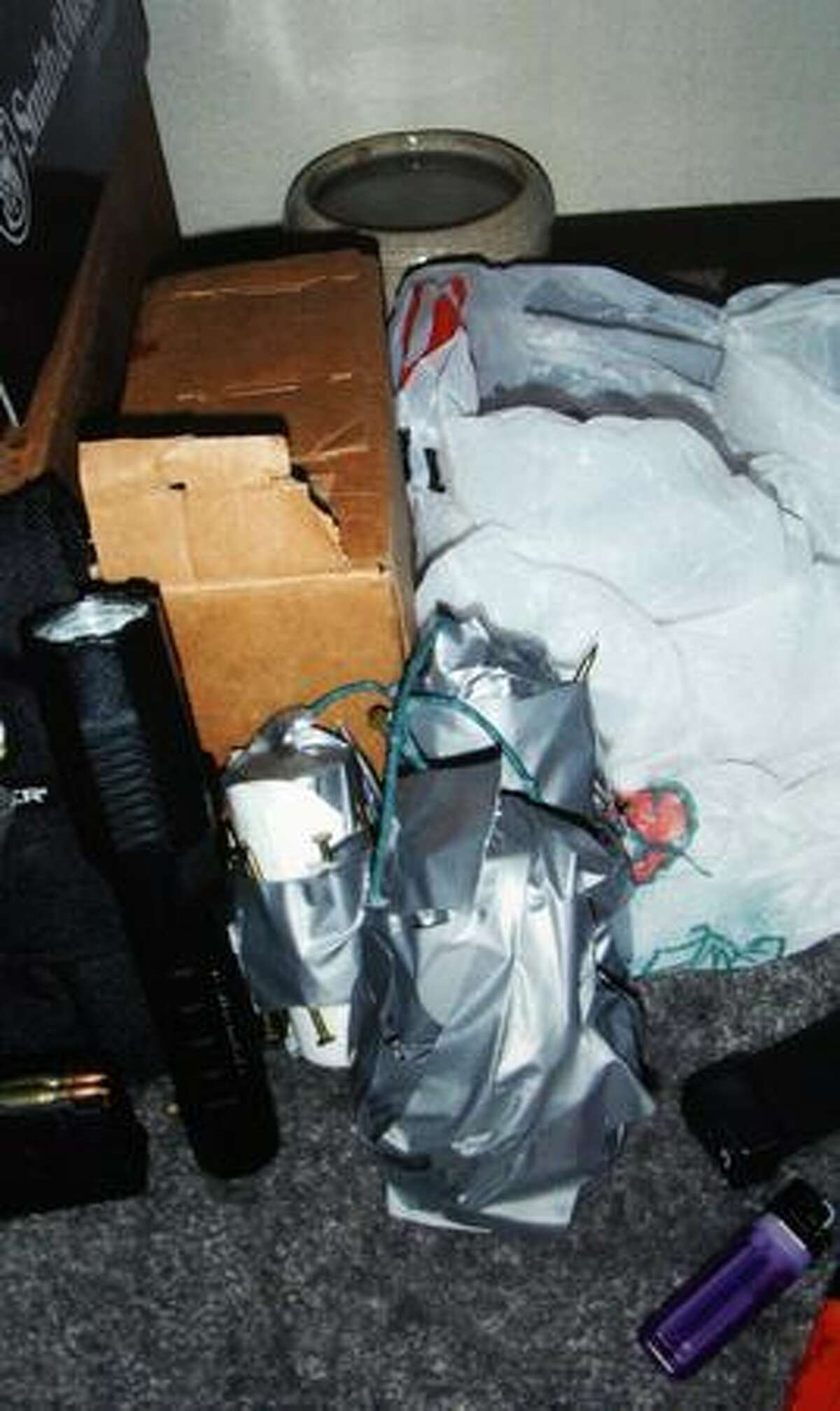 A police photo of evidence investigators said was seized at Christopher J. Monfort's Tukwila apartment. Police said DNA evidence linked him to the Oct. 22 arson of four police vehicles and the homicide of Officer Tim Brenton Oct. 31. (Seattle Police Department Photo)