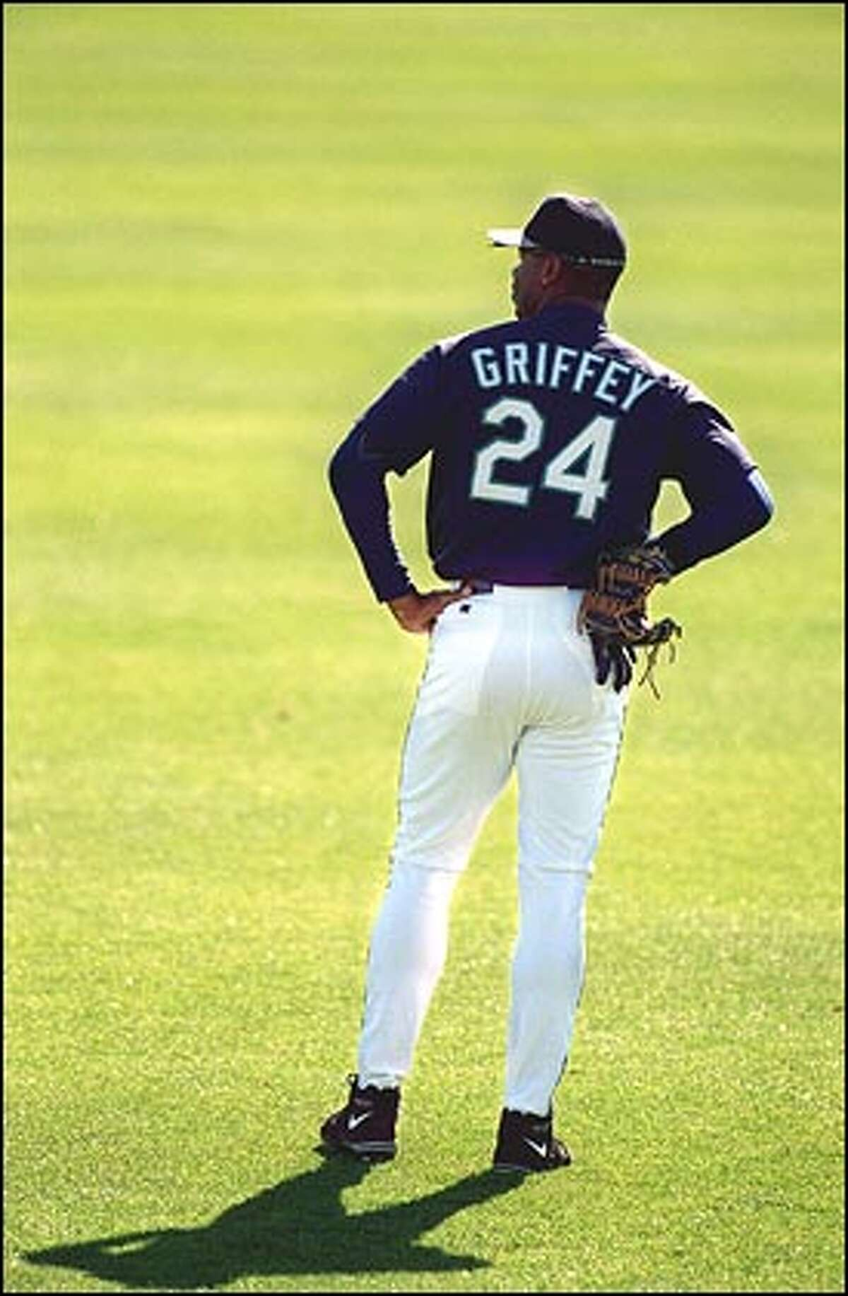 Ken Griffey Jr. waits to go to work in centerfield during a pre-season game in Peoria.