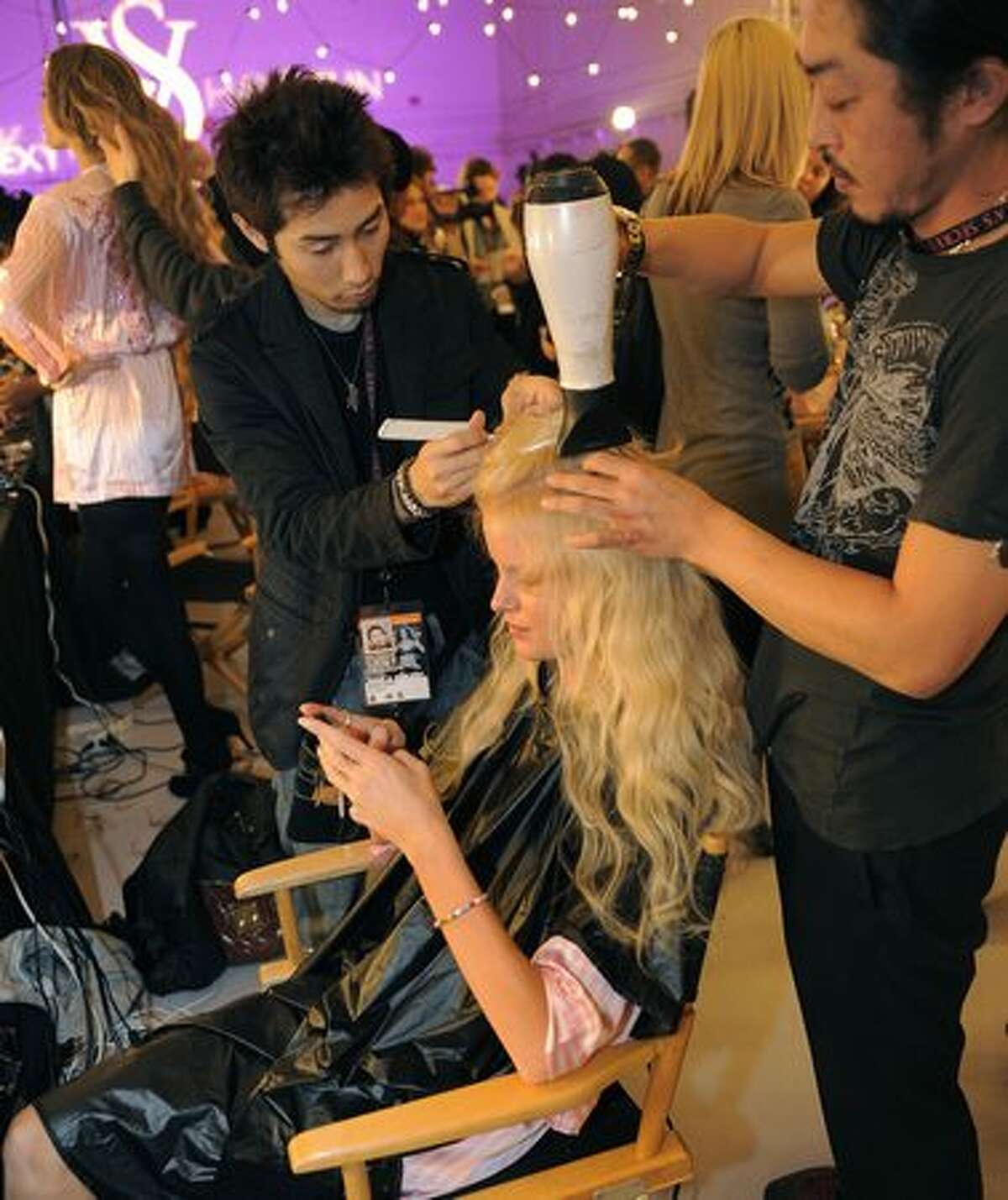 Victoria's Secret model Caroline Winberg backstage in hair and make-up before the start of the Victoria's Secret Fashion Show in New York.