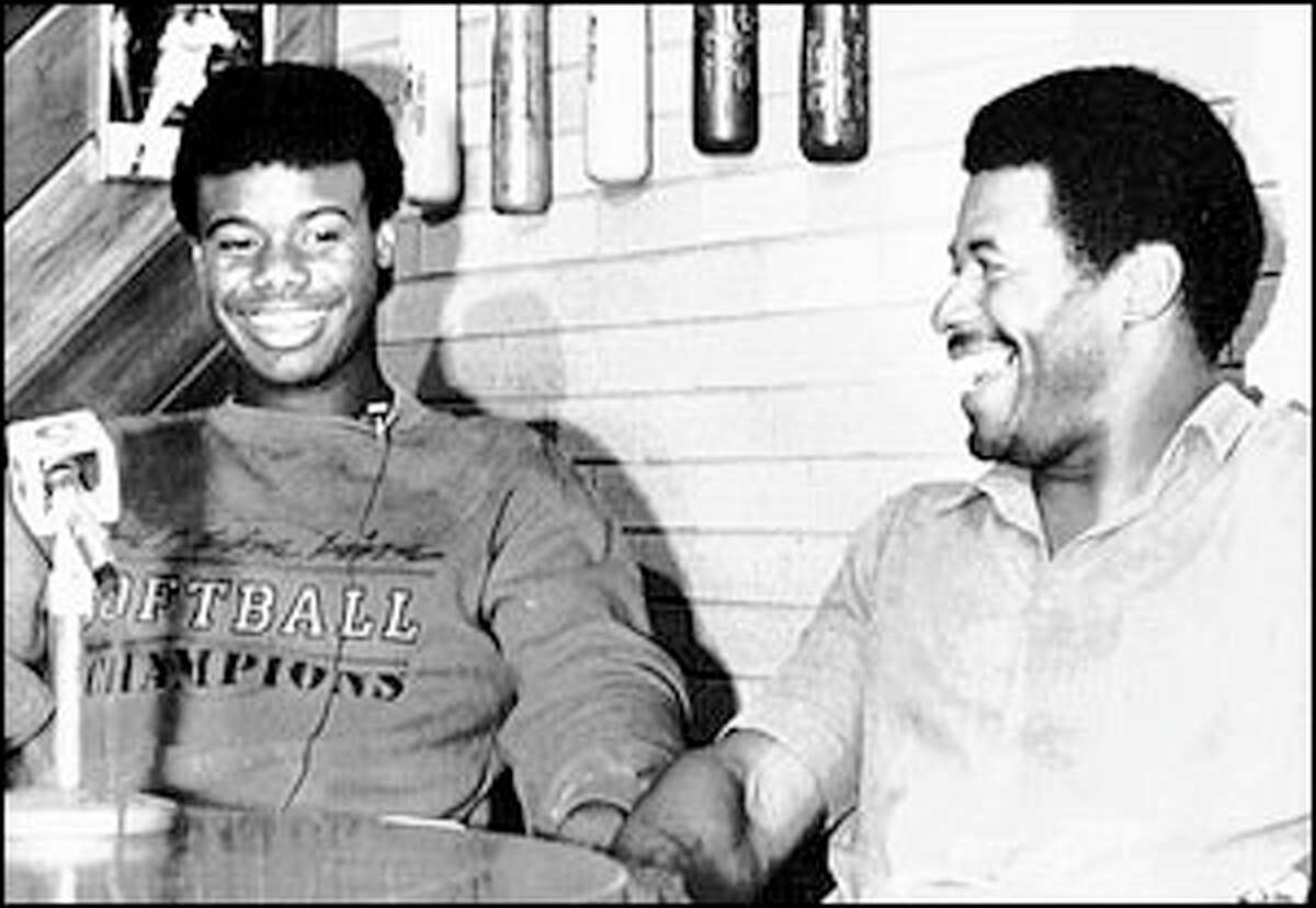 Ken Griffey Jr. sits with his father, Ken Griffey Sr., at a press conference after Junior was drafted by the Mariners.