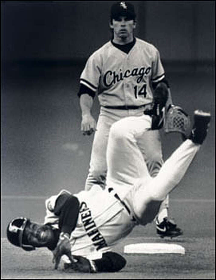 Ken Griffey Jr., dusted in a base-running collision after being hit by a pitch, sat down in the third inning with a sore tricep. Behind Griffey is Chicago shortstop Craig Grebeck. Photo: Seattle Post-Intelligencer