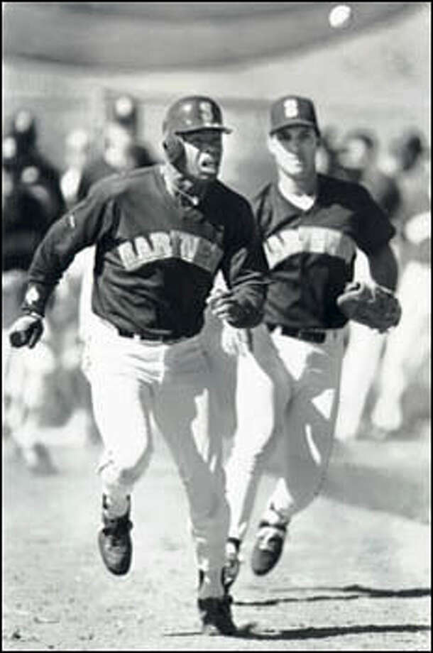 Ken Griffey Jr., then 19, and Tino Martinez in a baserunning drill during spring training in Arizona. Griffey would start the 1989 season with his major league debut after two years in the Mariners' farm system. Photo: Seattle Post-Intelligencer