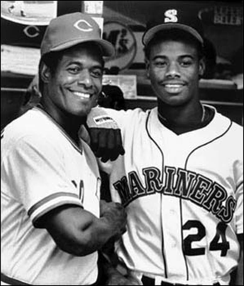 Ken Griffey Sr., left, poses with his son Ken Griffey Jr. Photo: Seattle Post-Intelligencer